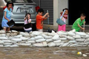 Children Helping with Flood Relief in Thailand