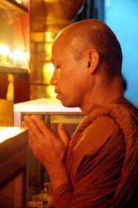 Buddhist Monk in Prayer