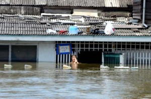 A Woman Submerged in Water in Thai Floods
