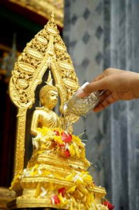 Pouring Water on the Buddha